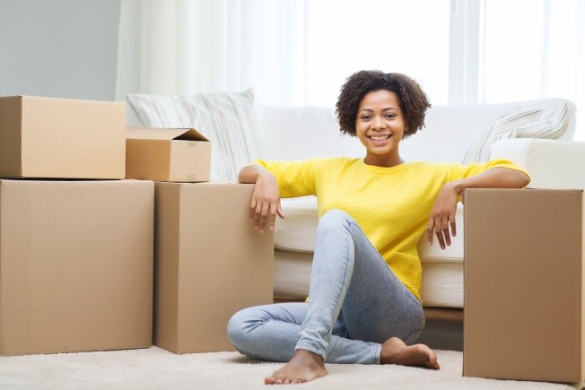 Woman Unpacking in New Apartment